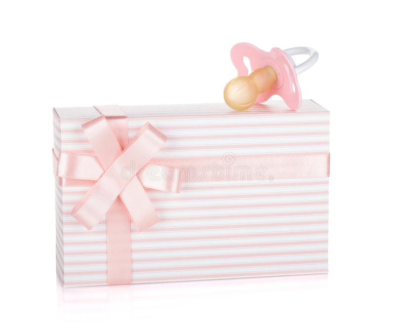 Cadre de cadeau et pacificateur pour la petite fille images stock