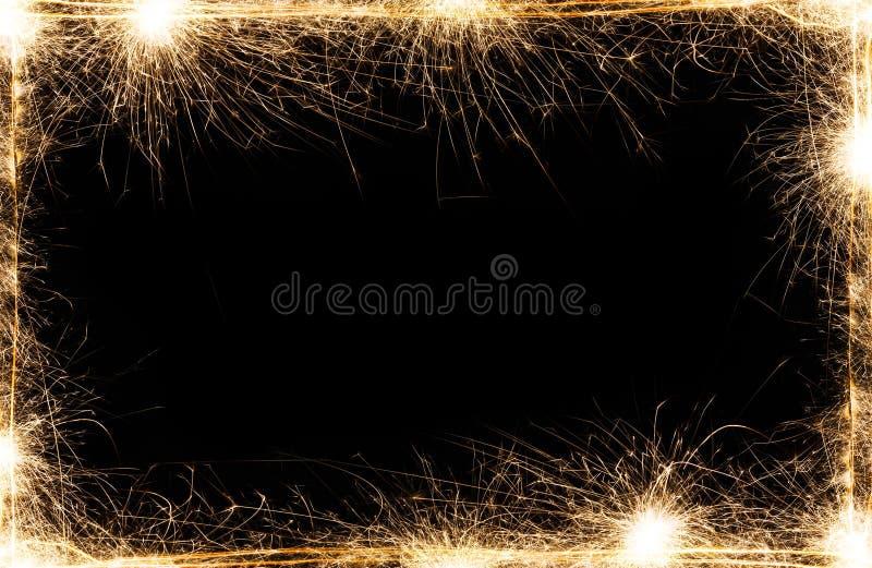 Cadre de cierges magiques de partie de nouvelle année sur le fond noir photos stock