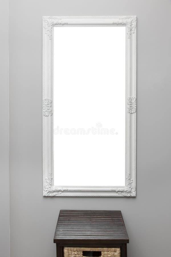 Cadre de miroir de vintage sur le mur gris image libre de droits