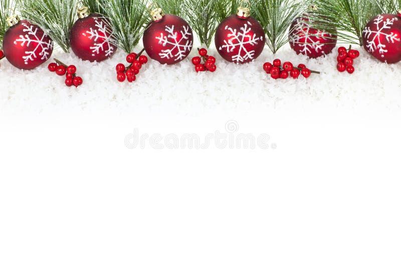 Cadre de Noël avec les ornements rouges photos libres de droits