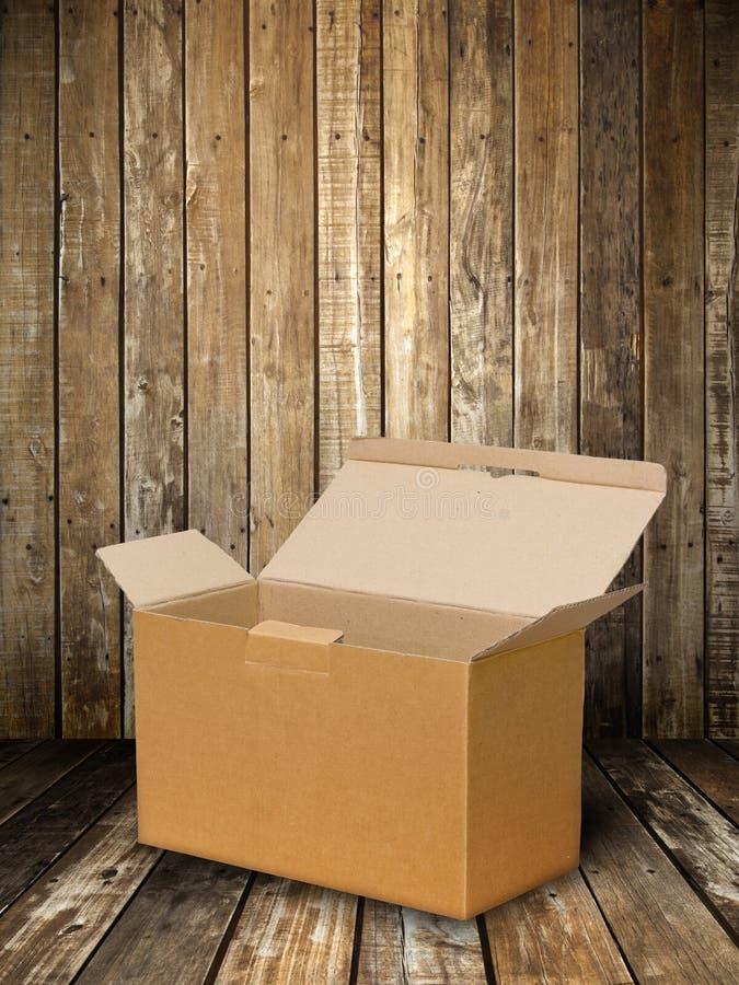 Cadre de papier de Brown sur l'étage en bois image stock