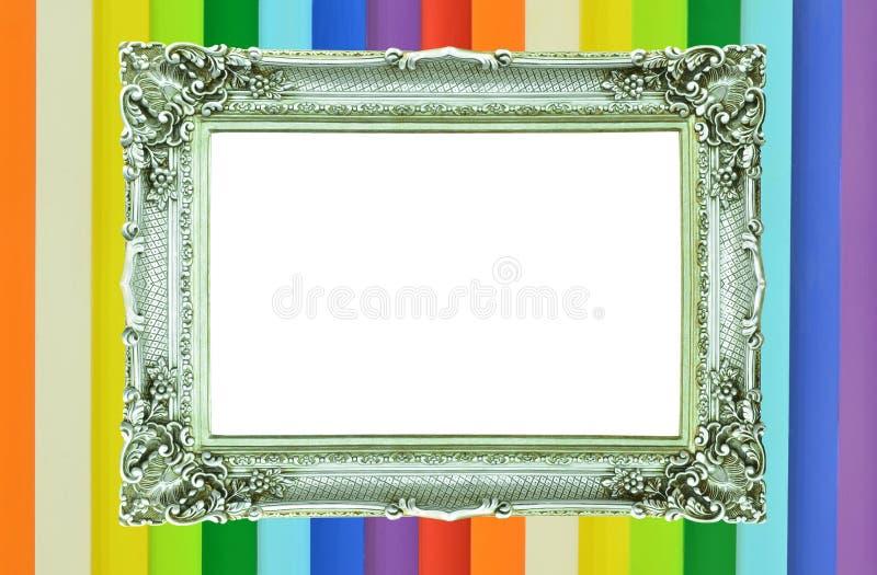 Cadre de tableau argenté de cru sur le mur coloré photos stock