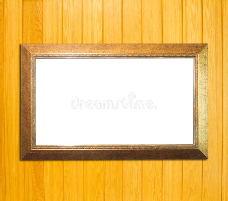 Cadre de tableau de vintage d'or sur le fond en bois photographie stock