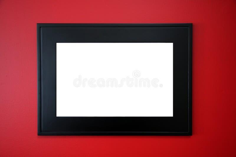 Cadre de tableau noir sur le mur rouge photos libres de droits