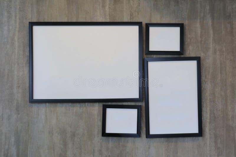 Cadre de tableau vide de vintage sur le mur en béton photographie stock libre de droits