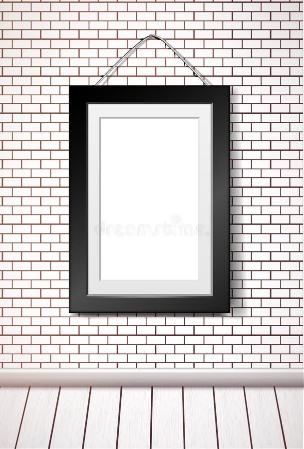 Cadre rectangulaire noir accrochant sur le mur de briques blanc illustration libre de droits