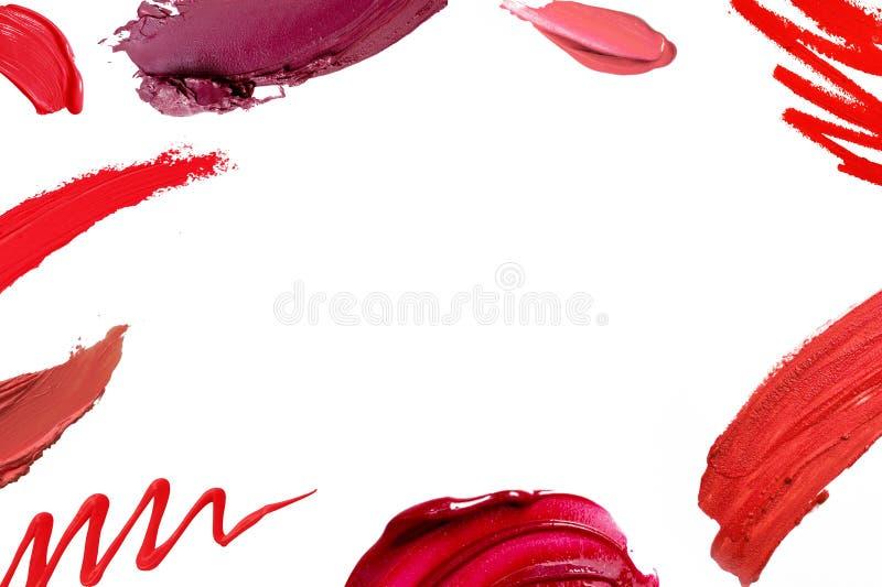 Cadre taché de texture d'abrégé sur rouge à lèvres image stock