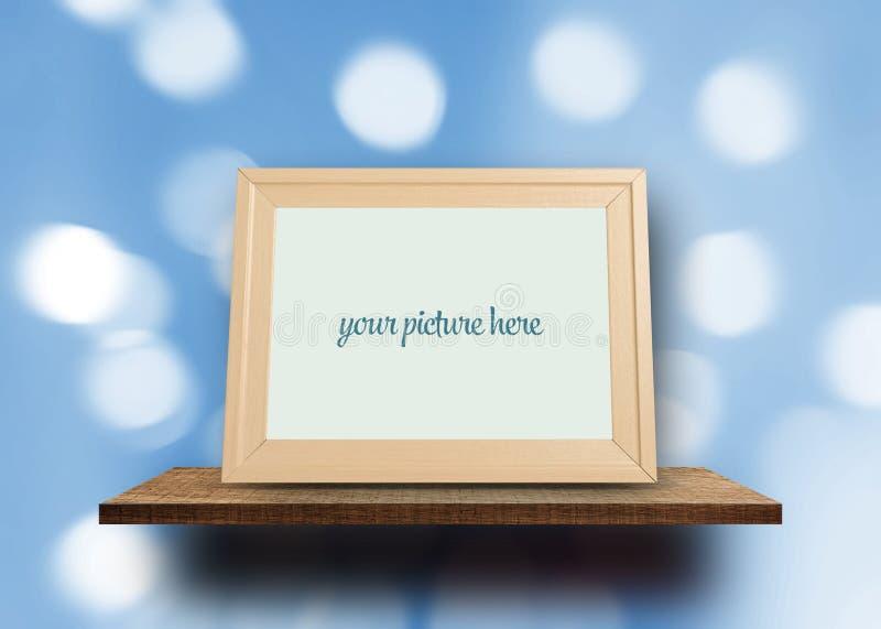 Cadre vide de photo sur le bokeh de tache floue photo stock