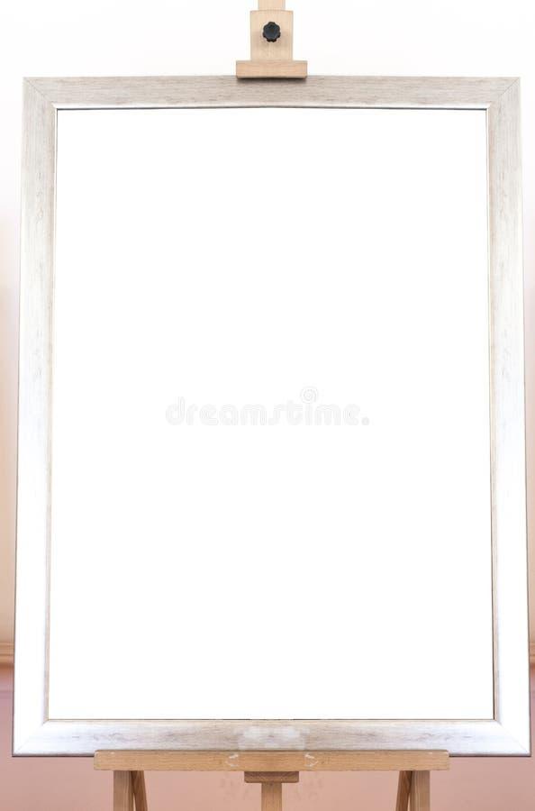 Cadre vide vide sur le chevalet de peinture, fond photographie stock