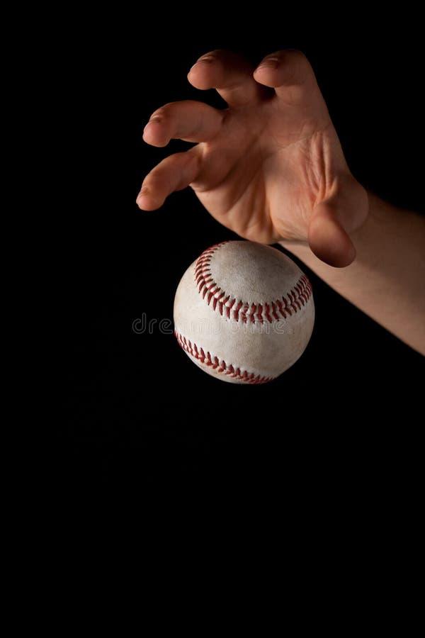 Caduta del baseball sul nero immagine stock