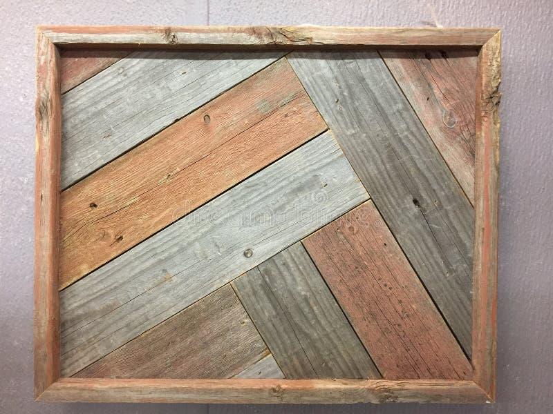 Caduta di legno della cornice sulla parete fotografie stock libere da diritti