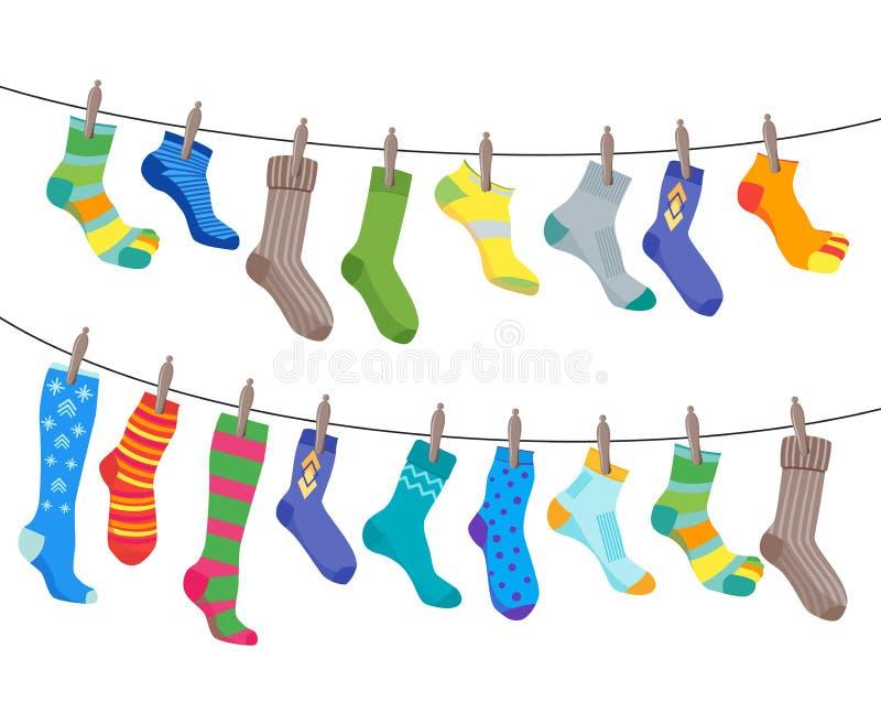 Caduta fissata calzini variopinti di divertimento sulla corda Vettore illustrazione di stock