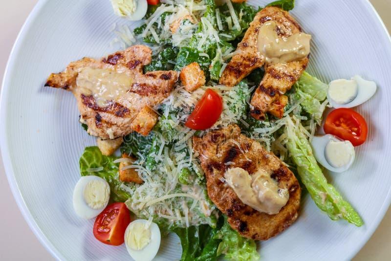 Caesar salad with chicken stock photos