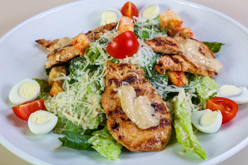 Caesar salad with chicken stock images