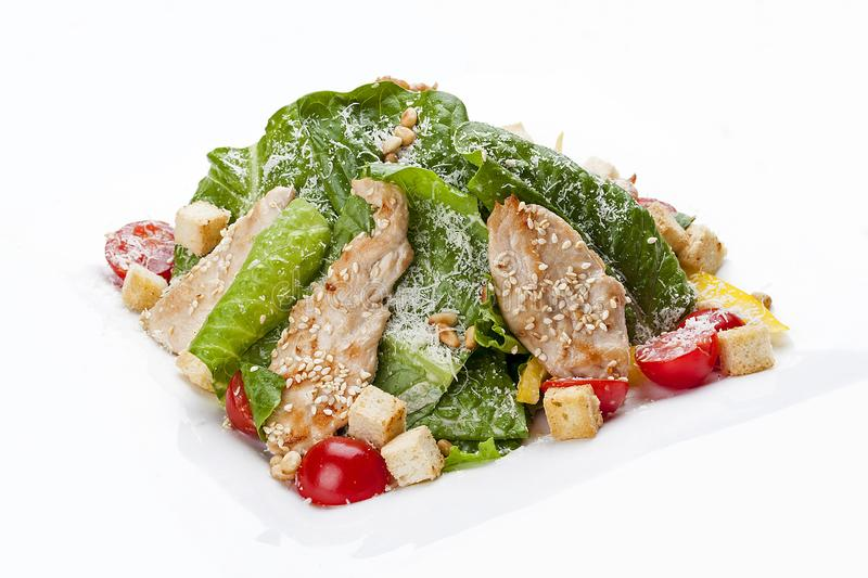 Caesar salad with chicken on a white plate stock image