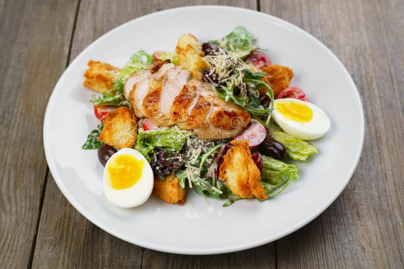 Caesar salad with fried chicken meat stock images