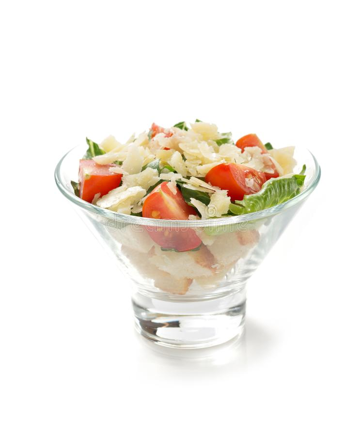 Caesar salad in glass bowl on white background royalty free stock images