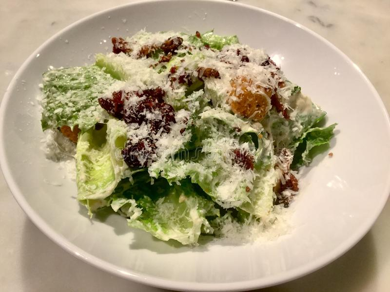 Caesar Salad . Gourmet. Fresh Salad dish. A Caesar salad is a green salad of romaine lettuce and croutons dressed with lemon juice, olive oil, egg stock images