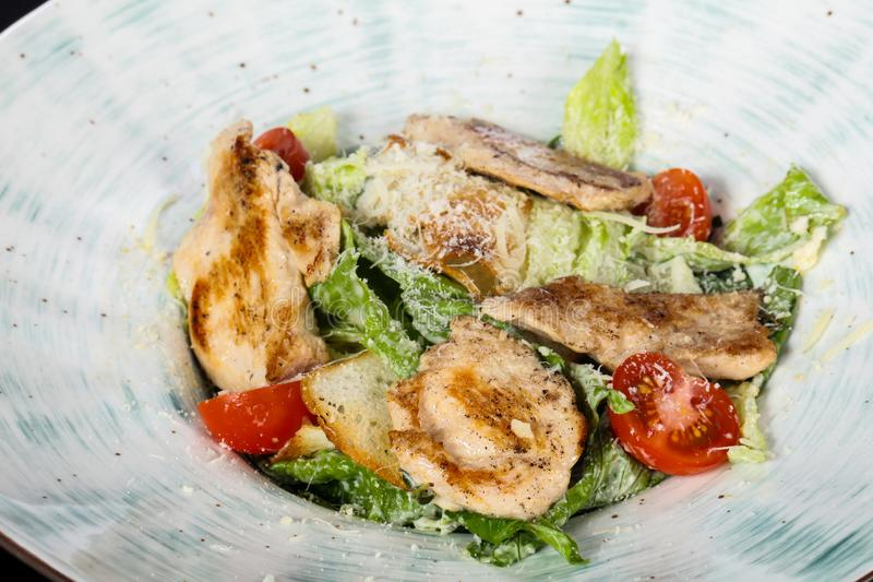 Caesar salad with grilled chicken stock images