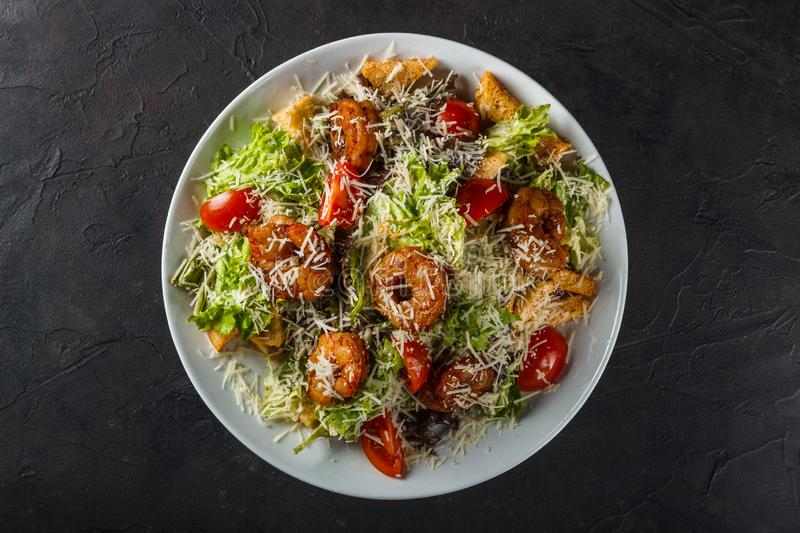 Caesar Salad with King Prawns, Parmesan Cheese and Cherry Tomatoes royalty free stock photo