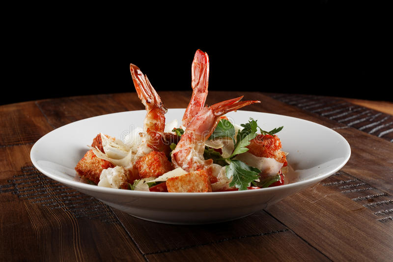 Caesar salad with king prawns royalty free stock photos