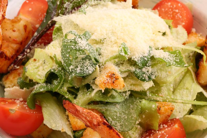 Caesar salad with king prawns and white sauce royalty free stock image