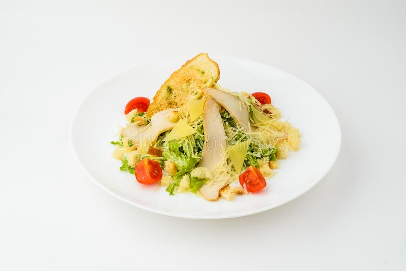 Caesar salad in plate isolated on white stock images