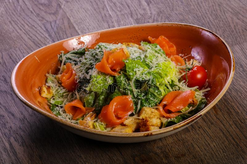 Caesar salad with salmon stock images