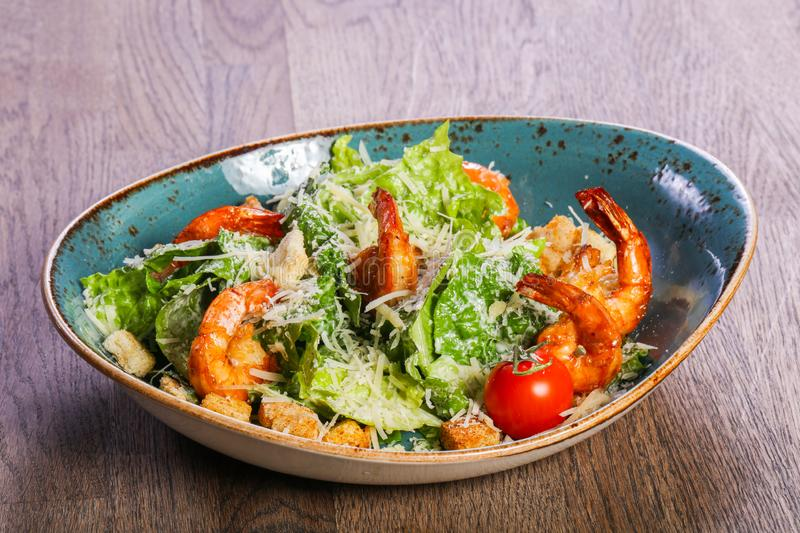 Caesar salad with shrimps stock photography