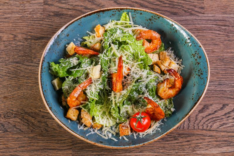 Caesar salad with shrimps stock images