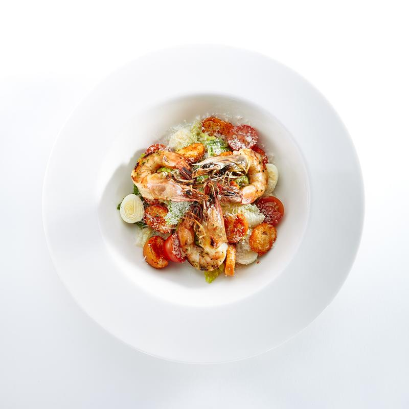 Caesar Salad with Tiger Shrimps Isolated royalty free stock photo