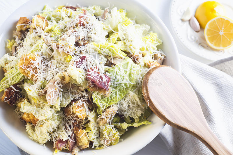 Caesar Salad with on white plate. Caesar Salad with on white plate; top view. Delicious Caeser salad with croutons; roasted chicken meat; parmesan cheese and royalty free stock images
