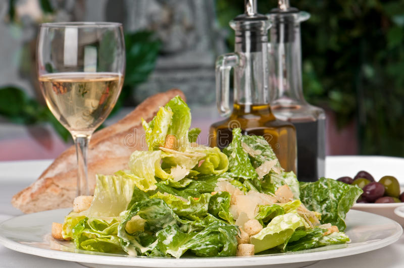 Caesar Salad and wine stock images