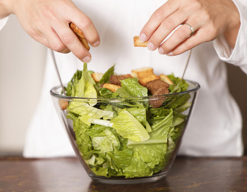 Download Caesar salad woman is hand stock photo. Image of background - 11867518