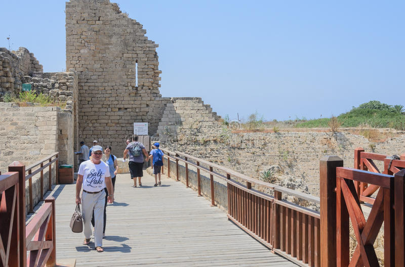 Caesarea, ISRAEL -July 30,The ancient park in Caesarea, Ancient fortress and people on the pedestrian bridge. ISRAEL -July 30,The ancient park in Caesarea royalty free stock photo