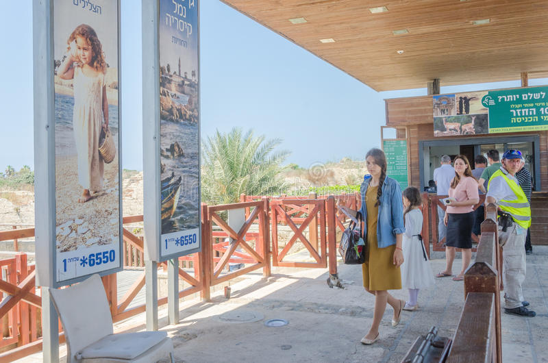 Caesarea,30 Jujy -Entrance to the ancient park in Caesarea. People near the banks , Caesarea , 2015 in Israel. ISRAEL -Entrance to the ancient park in Caesarea stock photography