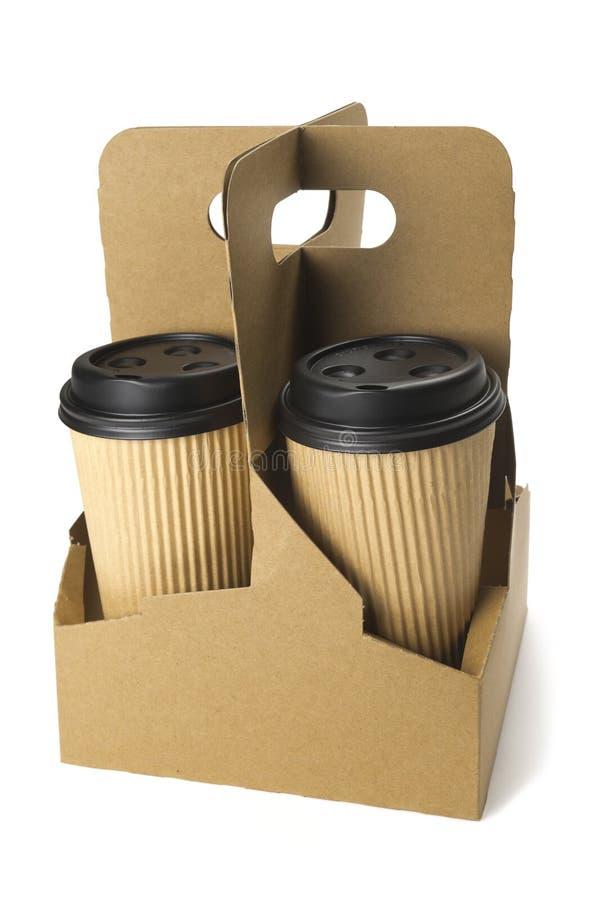 Café à emporter dans la cuvette thermo photographie stock
