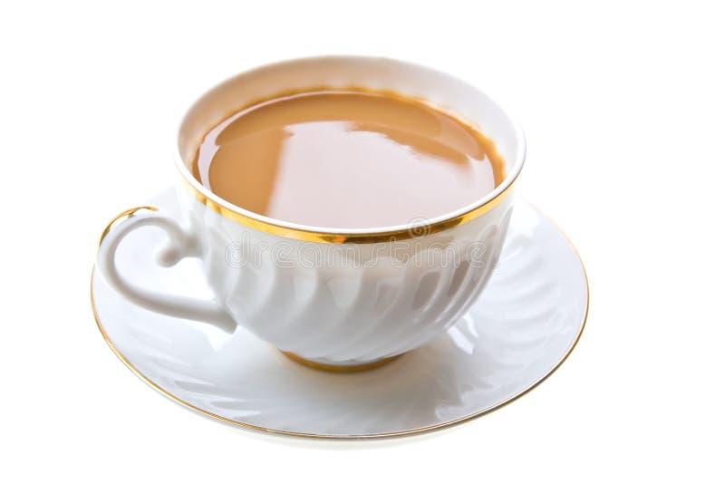 Café avec la cuvette de lait sur le blanc photographie stock