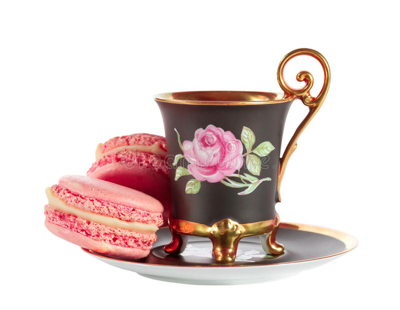 Café con los macarons franceses fotos de archivo
