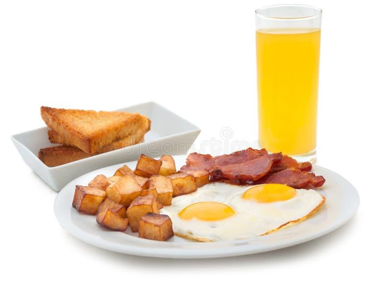 Café da manhã excelente do close-up dos ovos fritos e do presunto imagens de stock royalty free