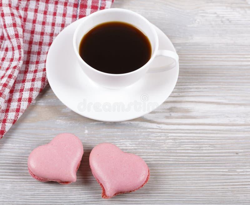 Café e bolinhos de amêndoa foto de stock