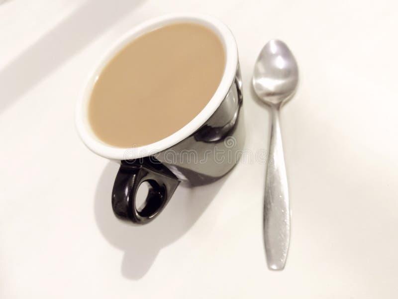 Café e colher imagens de stock