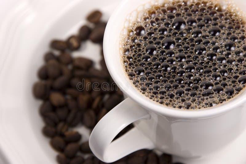 Café e feijões quentes imagens de stock