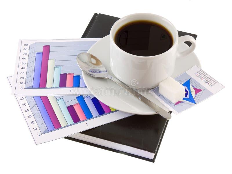 Café, estando no organizador, e diagramas. imagens de stock royalty free
