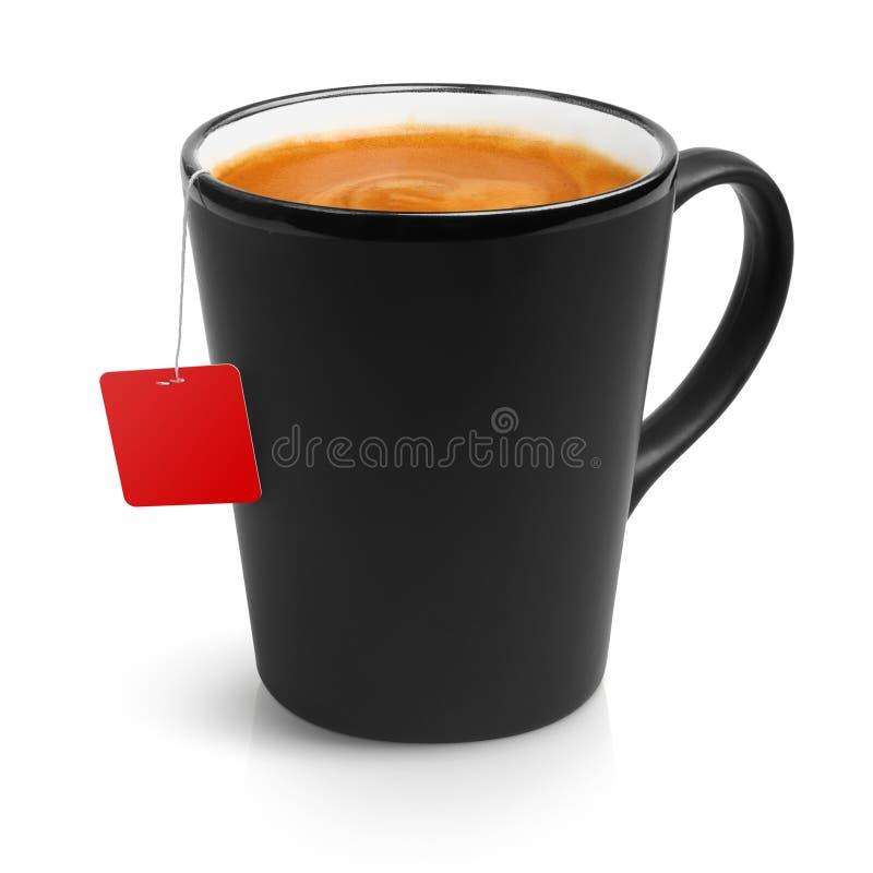 Café express d'un sac dans une grande tasse de noir photo stock