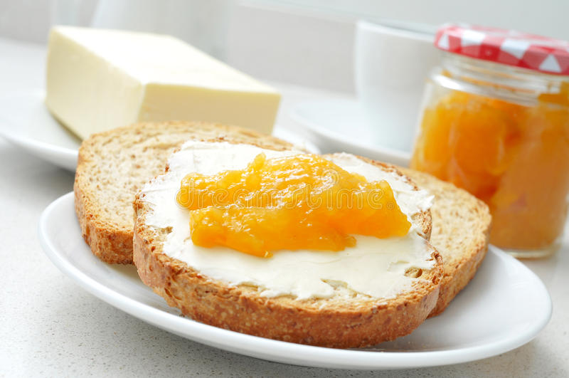 Café, pão, manteiga e doce imagens de stock royalty free