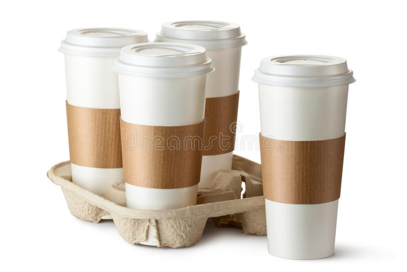 Café quatre à emporter. Trois cuvettes dans le support. photographie stock libre de droits