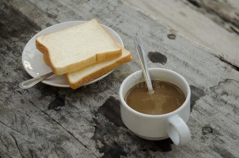 Café quente com manteiga do brinde com café da manhã fotos de stock royalty free