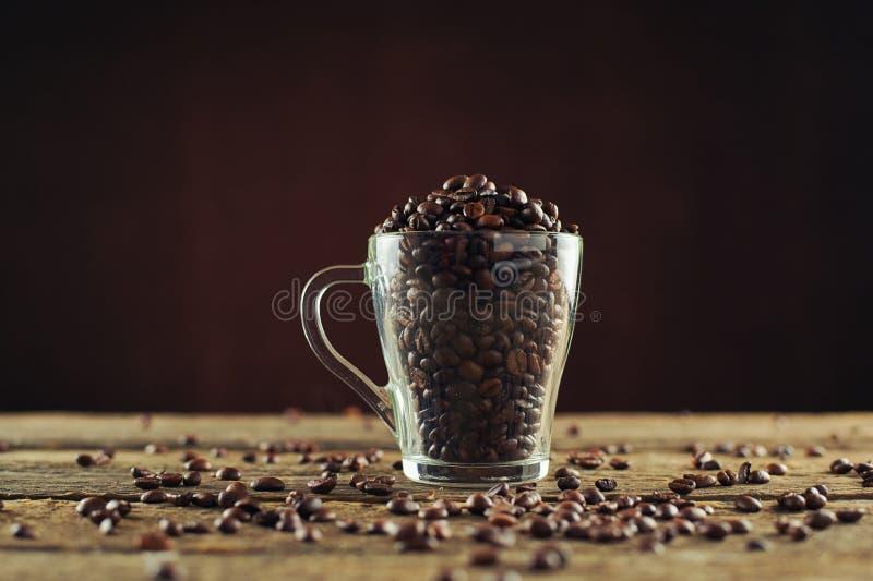 Café torrado em vidro fotografia de stock