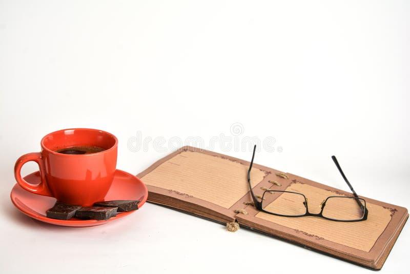 Café y cuaderno fotografía de archivo libre de regalías